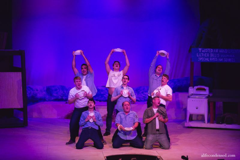 COURTESY PHOTO: A LIFE CONDENSED PHOTOGRAPHY - The men's ensemble performs a musical number from 'South Pacific' in the production by Theatre in the Grove, on stage now.