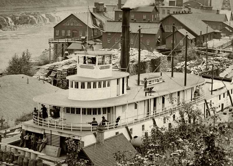 PHOTO AND RESEARCH COURTESY: OLD OREGON PHOTOS - Sternwheeler Ruth in Willamette Falls Locks, circa 1897.  By 1897, the pulp and paper mills at Willamette Falls were booming, as can be seen in the background of this photo of the sternwheeler Ruth in the locks. The falls themselves can be seen in the background. Ruth operated from 1895 to 1917 and was considered one of the fastest boats on the upper Willamette River. In addition to the Willamette, Ruth also worked on the Yamhill River, up to Dayton.