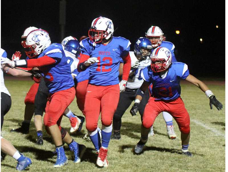 STEELE HAUGEN - Liam White and Jeremiah Smith lead block for the Buffalos. Madras beat Scio 20-18 Oct. 18. They have a big game against Corbett (5-2) at home at 7 p.m. Friday, Oct. 25. The outcome of the game could decide if the Buffs make the postseason.