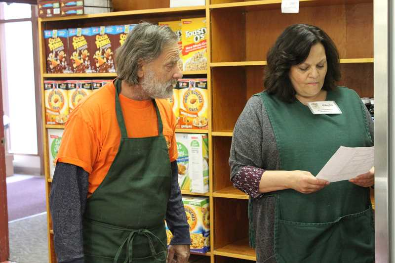 DESIREE BERGSTROM/MADRAS PIONEER - Ken Sexton and Cindy Greener fill a shopping list order for refrigerated and frozen items.