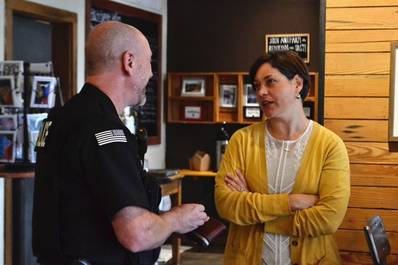 PMG PHOTO: BRITTANY ALLEN - Sandy Police Chief Ernie Roberts discusses possibe benefits of transient lodging tax dollars for the department with state Rep. Anna Williams.