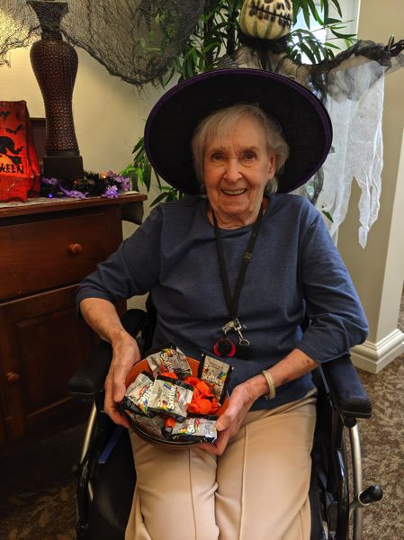 PMG PHOTO: BRITTANY ALLEN - Residents like Marvis Gary are excited to hand out candy to trick-or-treaters at Avamere on Oct. 31.
