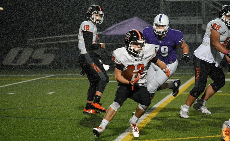 PMG PHOTO: MATT SINGLEDECKER - Beaverton senior running back Logan McRae makes a move during his team's 48-34 win over Sunset on Friday, Oct. 18.