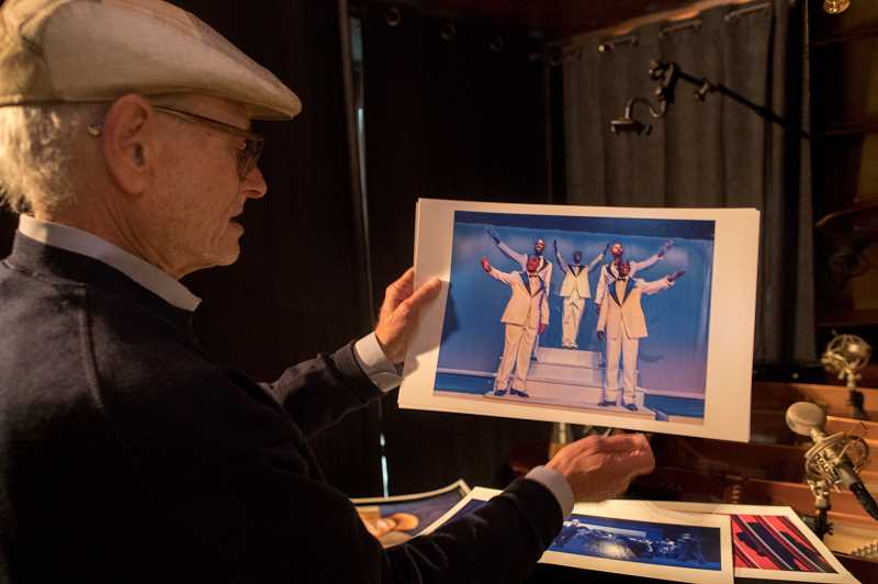 PGM PHOTOS: JAIME VALDEZ - Rabbi Alan Berg holds a picture of actors who were featured in Soul Harmony: The Story of Deborah Chessler, Sonny Til and the Orioles, A New Musical. Berg and local musician Michael Allen Harrison teamed up on the project.
