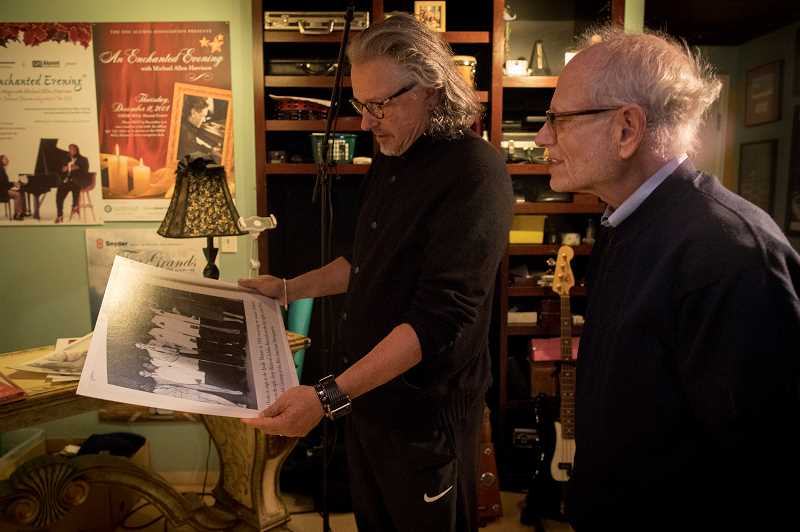 PGM PHOTOS: JAIME VALDEZ - Musician Michael Allen Harrison and Rabbi Alan Berg look at pictures that inspired them to work together on a project Soul Harmony: The Story of Deborah Chessler, Sonny Til and the Orioles, A New Musical.