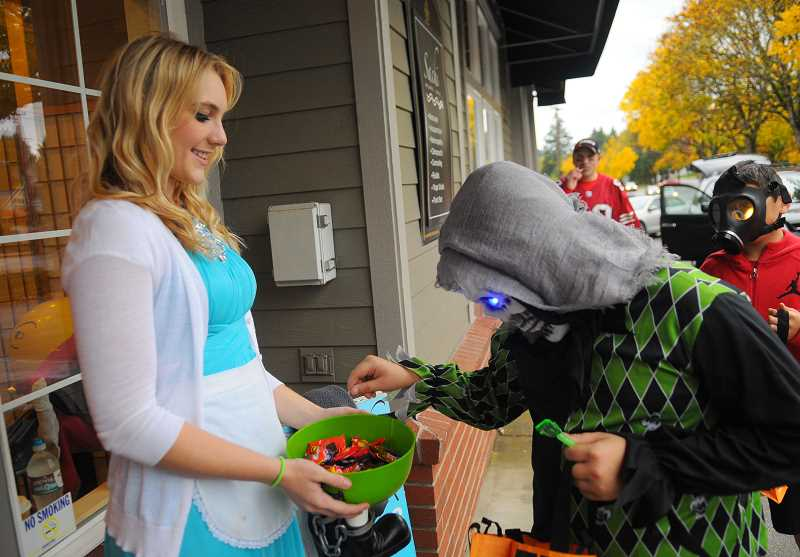 PMG FILE PHOTO - A trick-or-treater carefully selects his candy.