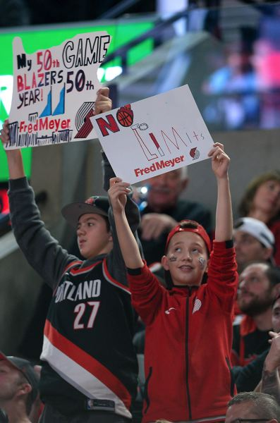 PMG PHOTO: CHRISTOPHER OERTELL - Young fans hold signs inside Moda Center during the Trail Blazers' NBA season opener on Wednesday night.