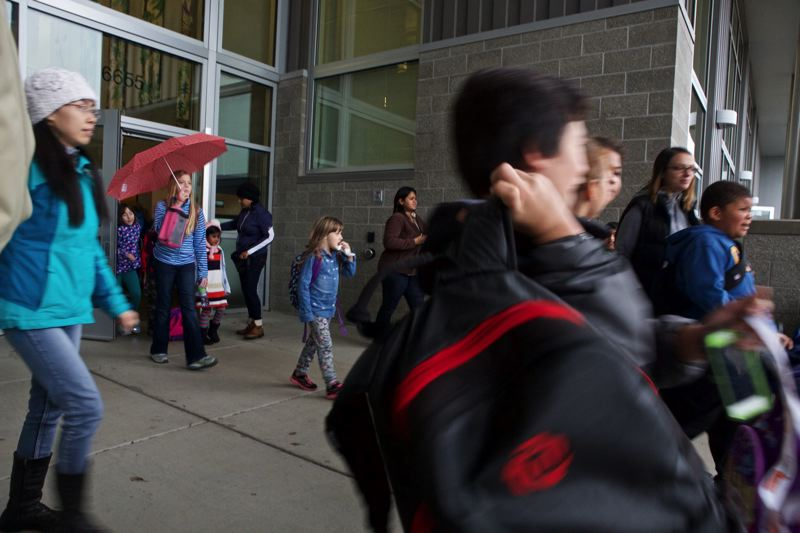 TIMES PHOTO: JAIME VALDEZ - Students rush out of Springville K-8 School in Beaverton. The school is one of two K-8 campuses in the Beaverton School District that will do away with the K-8 model.