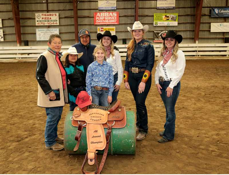SUBMITTED PHOTO - At left, saddle donors Marita and Delford Johnson surround Gentry Johnson, who tied with saddle winner Tallie Wood for Cowdeo all-around winners. Fair and rodeo court members from left, princess Brianna Smith, 2019 queen Lindsey Reynolds and 2020 queen Aschten Thomas, participated in the ceremony.