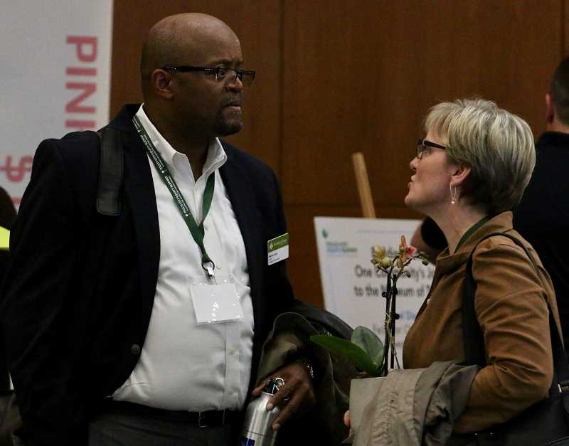 PMG PHOTO:  J. BRIAN MONIHAN - - West Linn-Wilsonville School District Superintendent Dr. Kathy Ludwig, right, chats with Summit keynote speaker Dr. Marvin Lynn.
