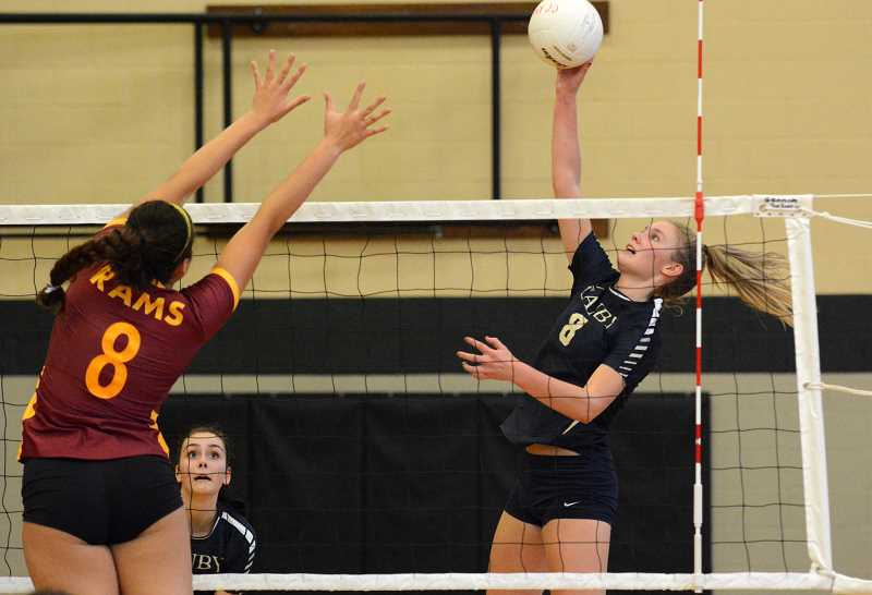 PMG PHOTO: DEREK WILEY - Canby outside hitter Daley McClellan hits the ball over the net against Central Catholic Saturday at West Linn. The Cougars advanced to the semifinals of the West Linn tournament and then defeated the Lions Tuesday in league play for the first time since 2010.