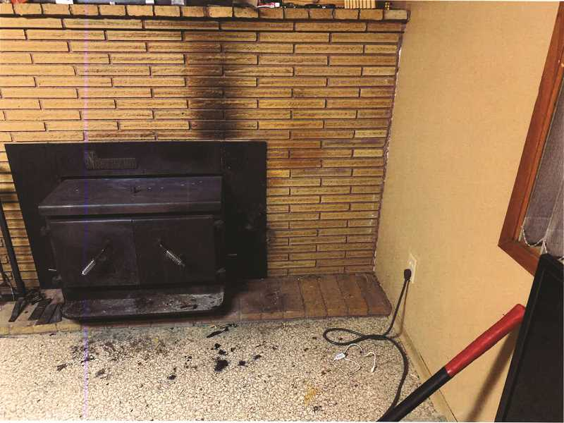 SUBMITTED PHOTO - Soot marks a fireplace in a residence on Southeast Eighth Street after heat from a fireplace insert caused adjacent firewood to catch fire and smoke.