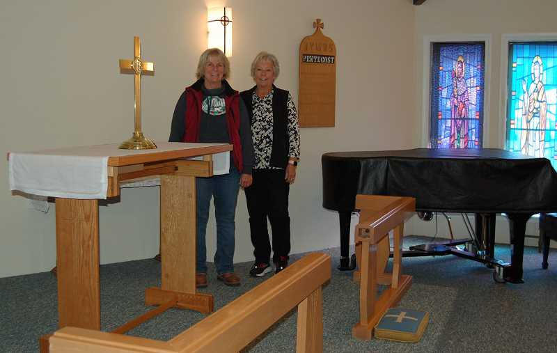 RAMONA MCCALLISTER - St. Andrew's Episcopal Church members Nancy Condron, left, and Jan Uffelman, right, stand at the front of the sanctuary of the church's new location at 680 NE Elm Street in Prineville.
