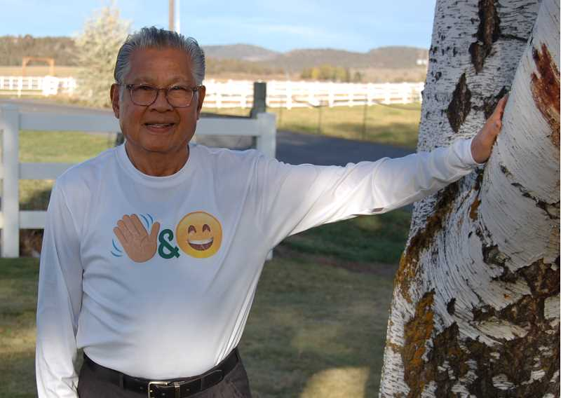 RAMONA MCCALLISTER - Fred Hosillos pauses for a photo with his shirt displaying his logo, 'make one difference to one person each day.'
