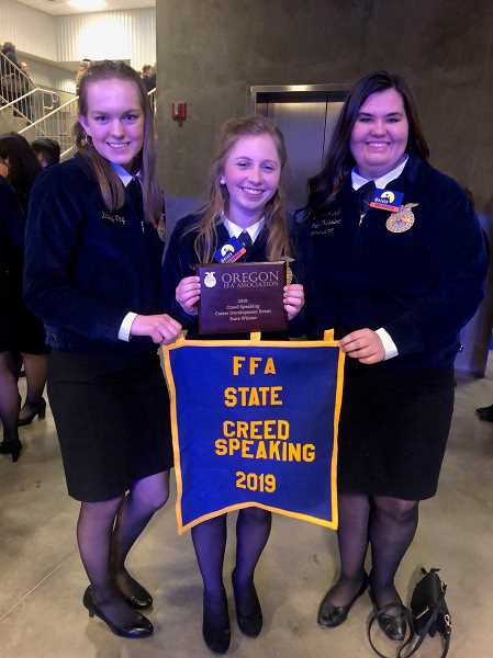 COURTESY PHOTO: CANBY FFA - Jessie Samarin, center, shows off her prizes for her first-place win in Creed Speaking at the state competition in April. From left to right are Katelyn Wing, Samarin and Lauren Iverson.