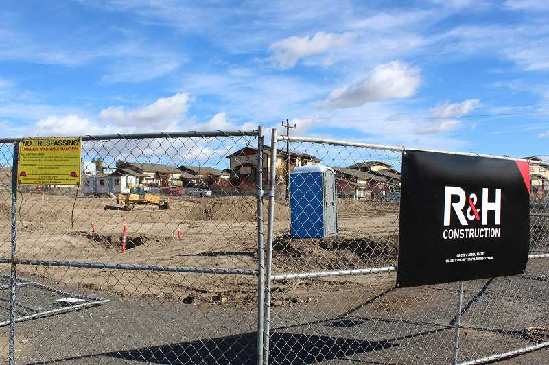 HOLLY M. GILL/MADRAS PIONEER - On Tuesday, R&H Construction was in the process of preparing a 1.27-acre parcel on Jefferson Street for construction of the 23-unit Red Canyon Apartments, which will serve low-income families.
