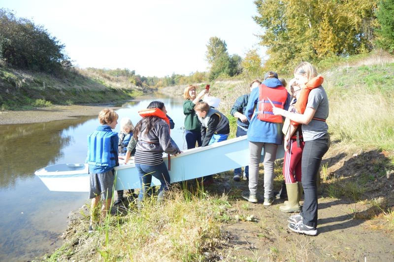 PMG PHOTO: NICOLE THILL-PACHECO - Seventh- and eighth-grade students from Sauvie Island School took their very own Beavins Skiff model boat on its maiden voyage on Wednesday, Oct. 23.