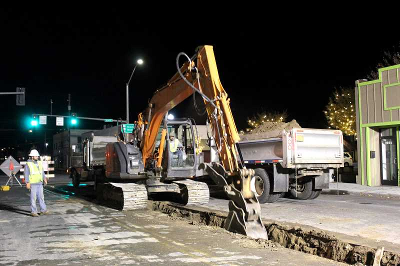HOLLY M. GILL/MADRAS PIONEER - Rocky Ridge Excavation and Hauling will be working nights through Thursday to install an 8-inch sewer line on D Street, between Fourth and Fifth streets.