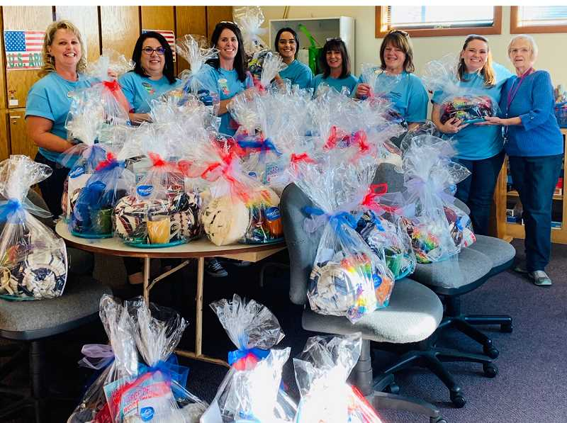 SUBMITTED PHOTO - On Columbus Day, Mid Oregon Credit Union employees still reported to work, but instead of banking, they were working to give back to the community. From left to right are Teri Drew, Deanna Shaw, Tammy Gregory, Angie Lopes, Maureen Rogers, Megan Hansen and Louise Muir.