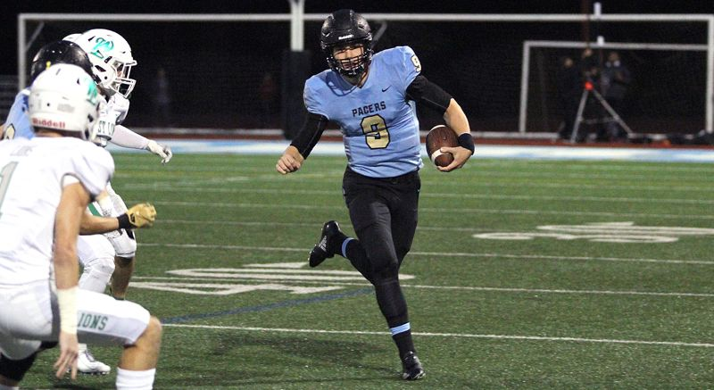 PMG PHOTO: MILES VANCE - Lakeridge senior Cooper Justice has proven himself a threat with both his arm and legs in the 2019 season as the Pacers' starting quarterback.