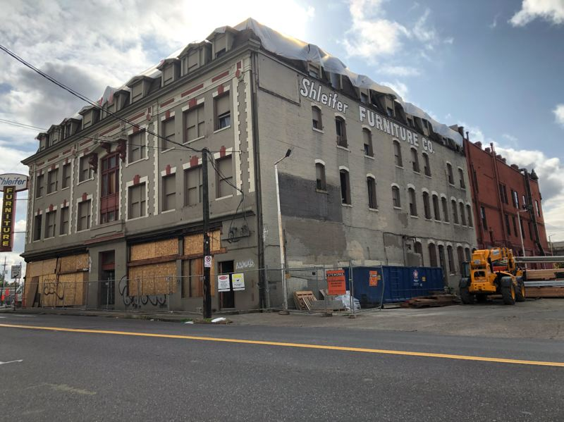 PMG PHOTO: STEPHANIE BASALYGA - The masononry brick building that served as the showroom of Schleifer Furniture for 80 years is being renovated back to its original use as a hotel.