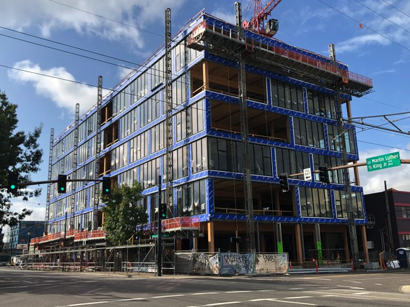 PMG PHOTO: STEPHANIE BASALYGA - The District Office building will feature cross-laminted timber floors and glulam timber framing for upper-level office spaces and concrete for foundation levels.