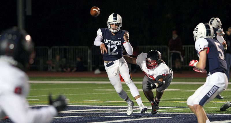 PMG PHOTO: MILES VANCE - Lake Oswego junior quarterback J. J. Woodin has gotten better and better as the season has worn on for the Lakers, now wth over 1,000 yards passing and 10 TD throws.