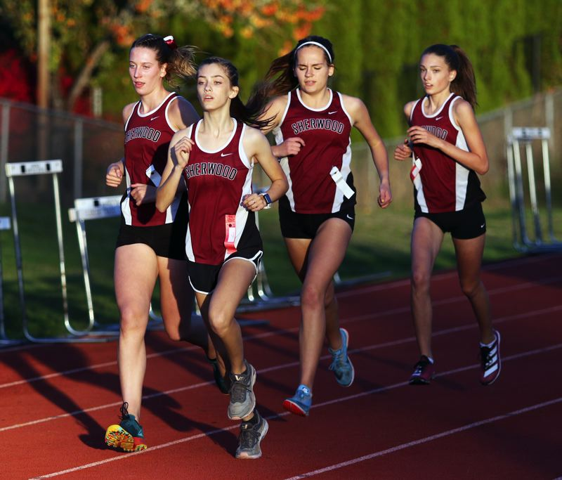 PMG PHOTO: DAN BROOD - A pack of Sherwood girls runners, including, from left, Brooke Smith, Kari Eddington, Vanessa Van Winkle and Kaylyn Murphy led the way for the Lady Bowmen early in the race at Glencoe.