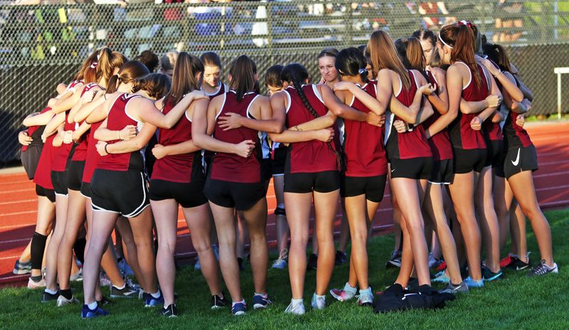 PMG PHOTO: DAN BROOD - The Sherwood girls cross country team gathers before the start of its race at Glencoe on Oct. 23. The Lady Bowmen won to improve to 6-0 in Pacific Conference meets.