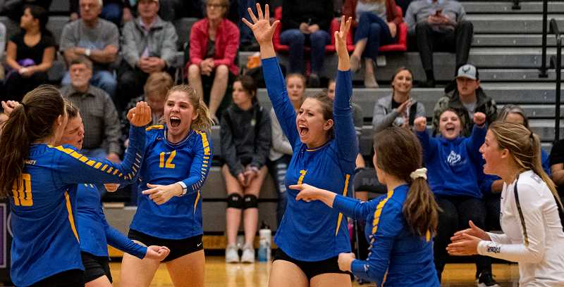 LON AUSTIN/CENTRAL OREGONIAN - From left to right, McKenzie Jonas, Kenna Woodward, Anna Woodward, Lily Cooper, Stormie Camara and Kacie Stafford celebrate after a key point in the third set of the Cowgirls match with Ridgeview. The Ravens went on to win in four sets.