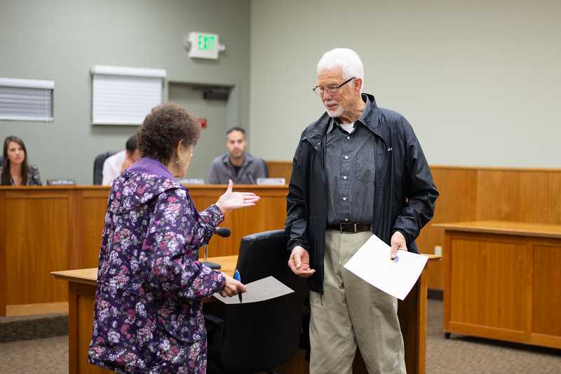 PMG PHOTO: ANNA DEL SAVIO - Peter McHugh was sworn into office by Columbia County Clerk Betty Huser at the Scappoose City Council's Oct. 14 meeting.