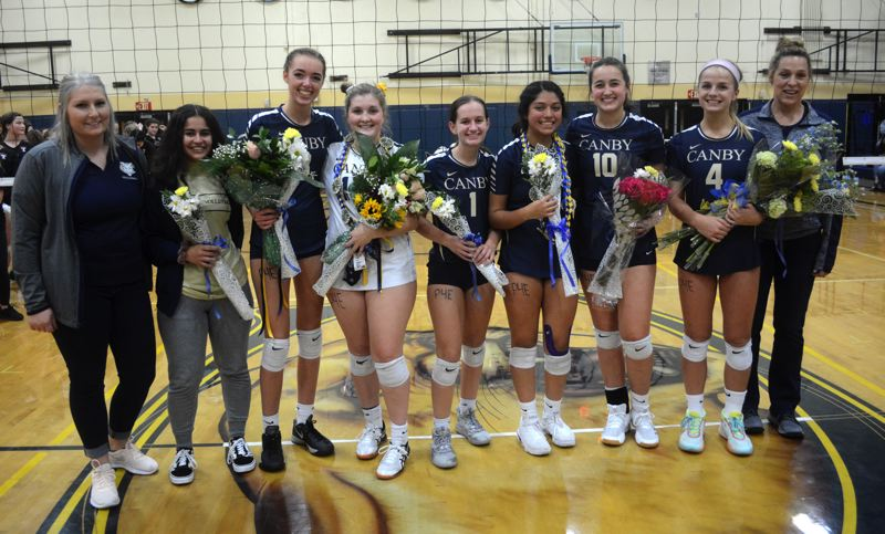 PMG PHOTO: DEREK WILEY - Canby honored its six seniors and one exchange student before Thursday's match.