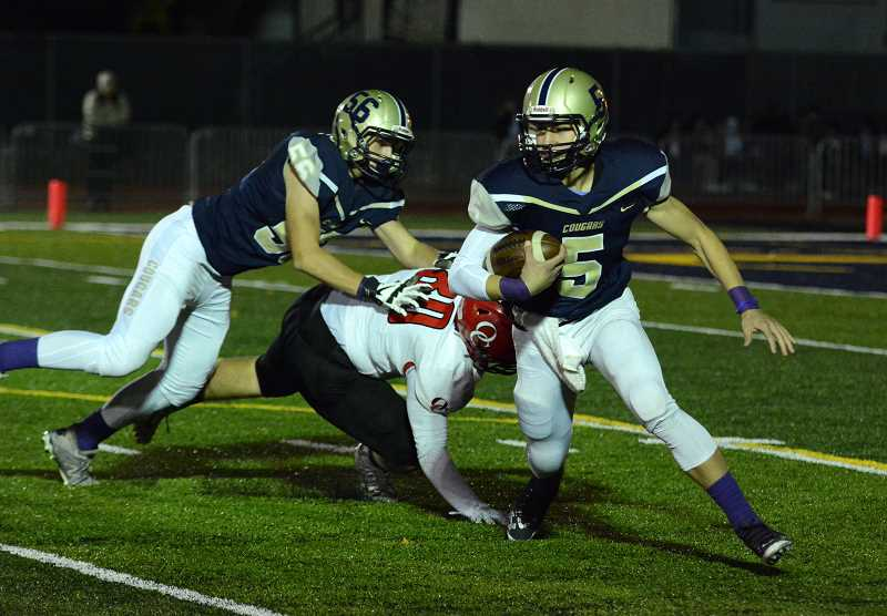 PMG PHOTO: DEREK WILEY - Canby quarterback Mikey Gibson runs the ball against Oregon City.