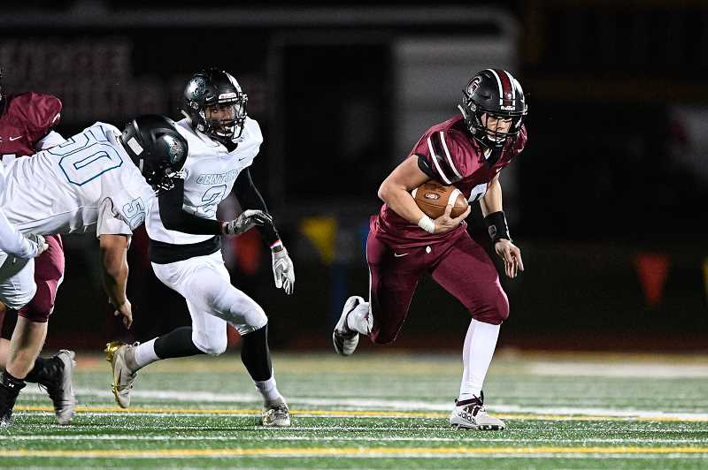 PMG PHOTO: CHRISTOPHER OERTELL - Glencoe quarterback Carson Wilson runs from the Century defense during the Tide's game against the Jaguars Friday night, Oct. 25, at Hare Field.