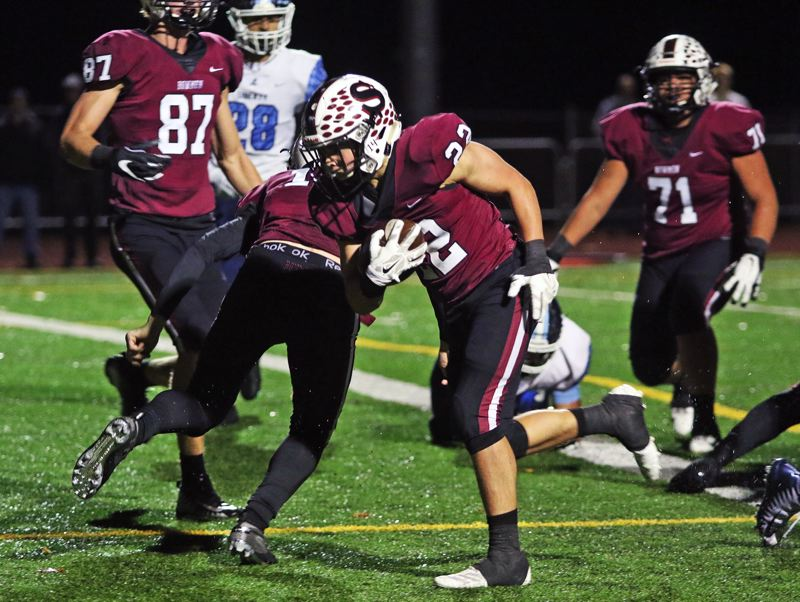 PMG PHOTO: DAN BROOD - Sherwood High School junior running back Holden Gilbert scores on a 1-yard run during the second quarter of the Bowmen' 56-7 win over Liberty on Friday.