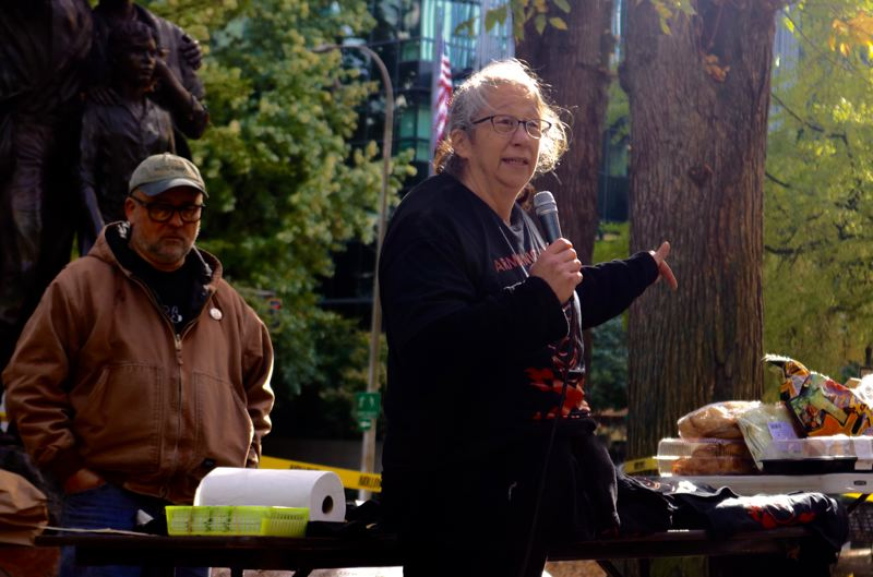 PMG PHOTO: ZANE SPARLING - Laura Kealiher spoke during a memorial for her slain son in Chapman Square in downtown Portland on Saturday, Oct. 26.