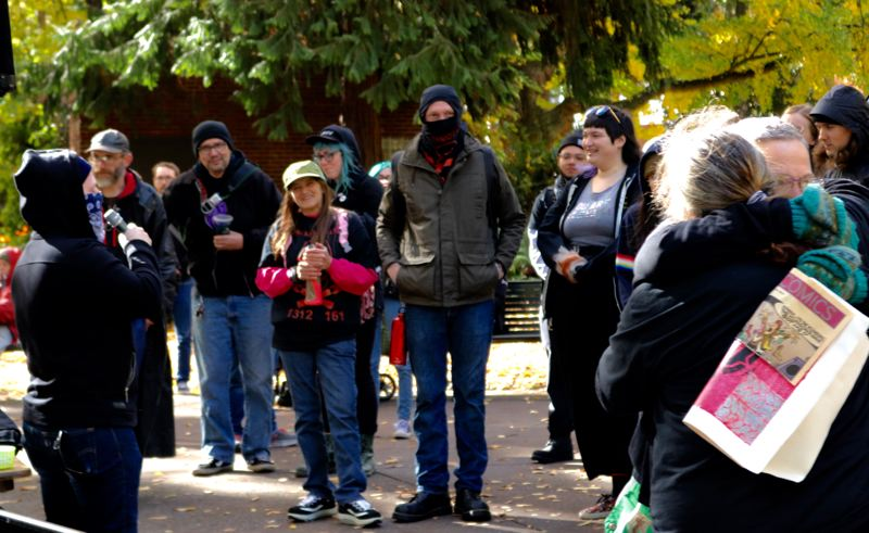 PMG PHOTO: ZANE SPARLING - Mourners, some dressed in black, honored the memory of Sean Kealiher in Portland on Oct. 26.