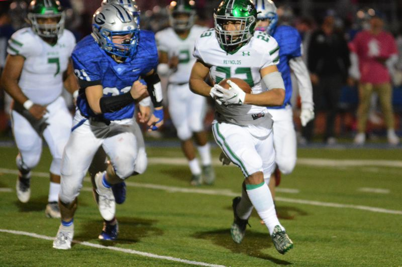PMG PHOTO: DAVID BALL - Reynolds running back Keedin Branch moves around the corner for a first down.
