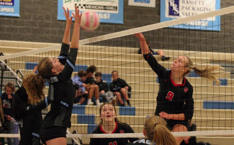 MPG PHOTO: JIM BESEDA - Oregon Citys Emma Pruitt (9) had four kills, a team-high seven blocks, and two service aces in Wednesdays Three Rivers League road win to close out the regular season.