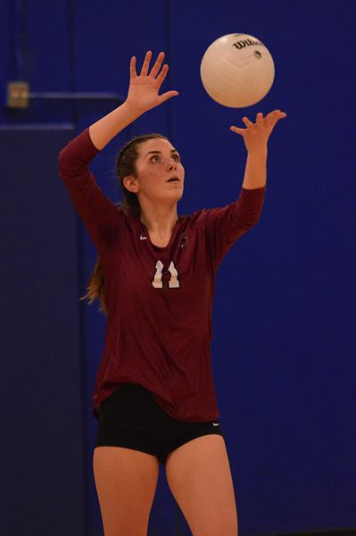 PMG PHOTO: DAVID BALL - Sandy setter Chloe Bierbrauer prepares to hit a serve.