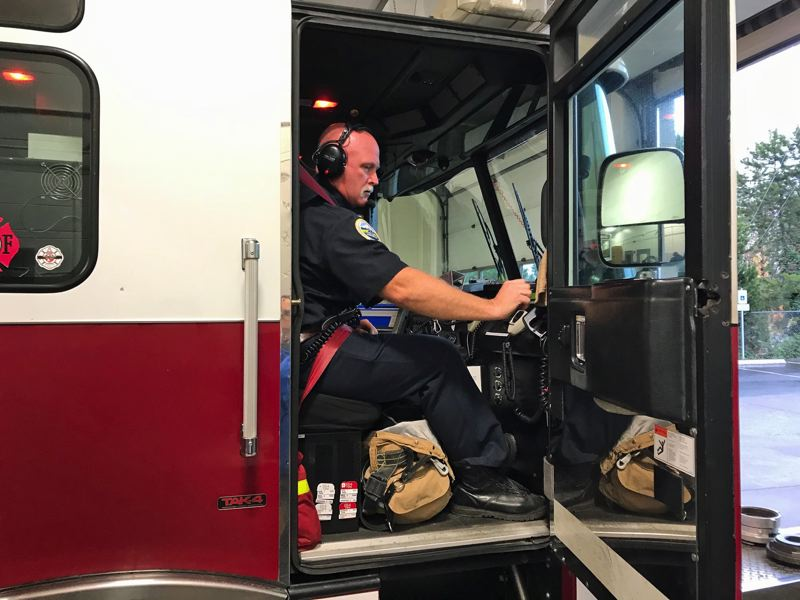 PMG PHOTO: DANA HAYNES - Lt. Trevor Herb of Tualatin Valley Fire & Rescue responds to a call last July from Station 64 north of Hillsboro.
