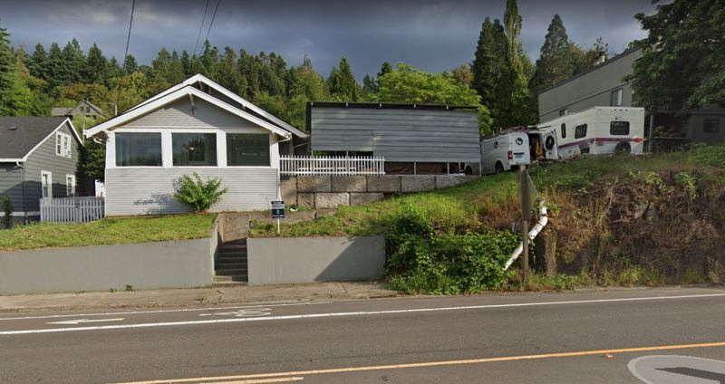 COURTESY PHOTO: GOOGLE MAPS - Oregon City owns the public property where someone has built a gray, square shed in the center of this view off McLoughlin Boulevard.