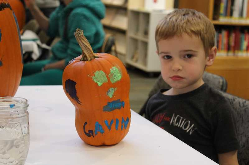 PMG PHOTO: ASIA ALVAREZ ZELLER - Gavin Molnar, 4, poses with his completed pumpkin art.