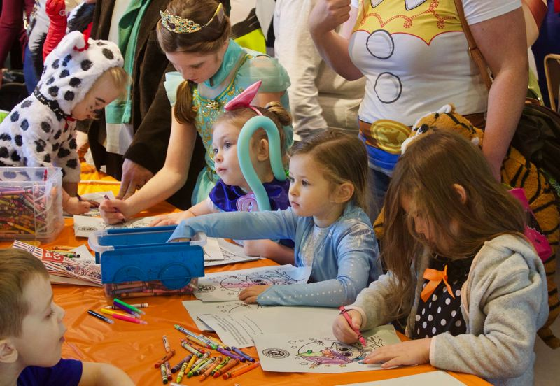PMG PHOTO: CHRISTOPHER KEIZUR - Children enjoyed an arts and crafts booth during the Gresham Station Halloween Spooktacular Sunday afternoon, Oct. 27.