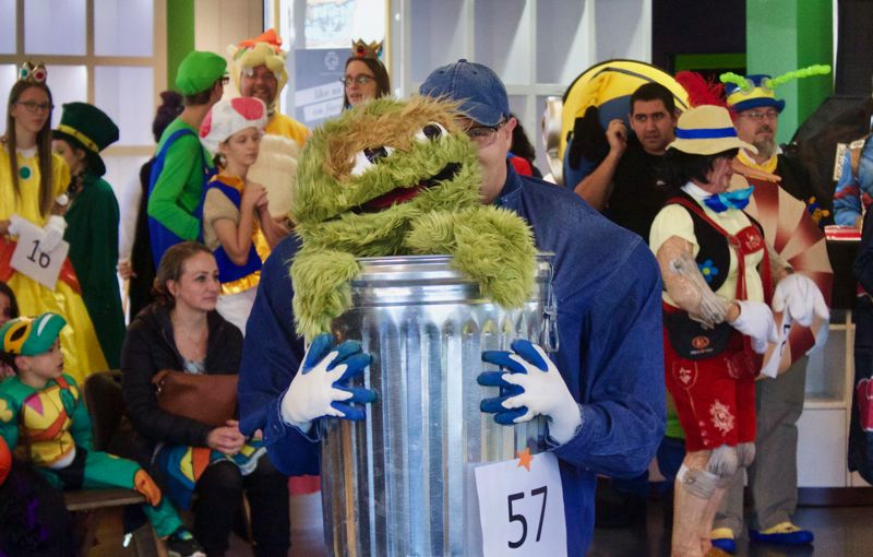 PMG PHOTO: CHRISTOPHER KEIZUR - Oscar the Grouch visited Gresham Station for the afternoon of fun.