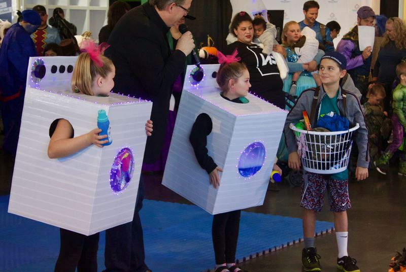 PMG PHOTO: CHRISTOPHER KEIZUR - One of the three Disneyland trip winners was the Rattley family for dressing as a washing machine, dryer and dirty laundry.
