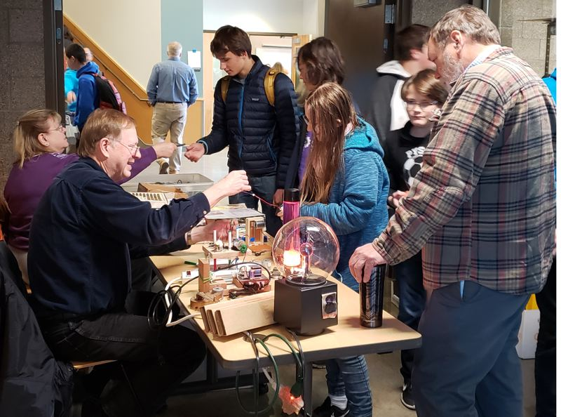 Robotics enthusiasts select electronics components at Gladstone's 10th annual FIRST Fair, which provides workshops to high school teams from across Oregon.