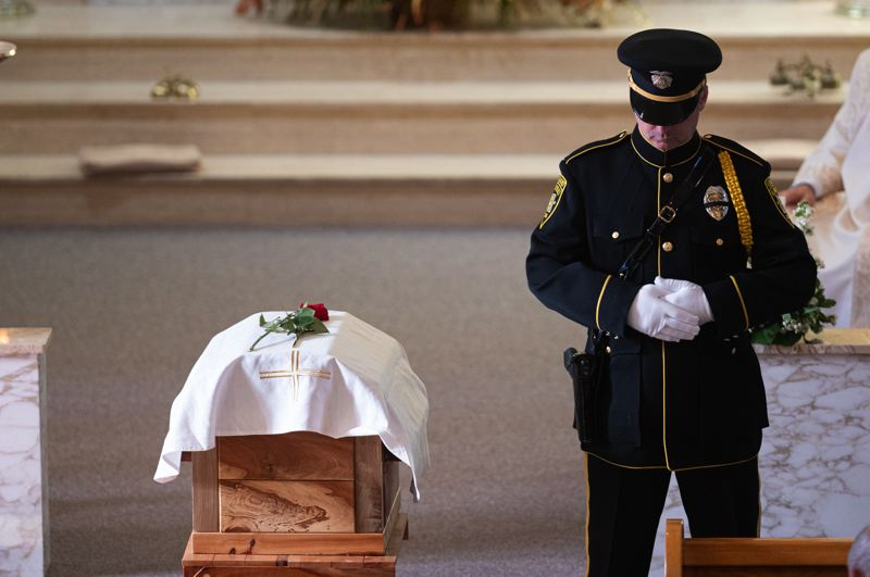 PMG PHOTO: CHRISTOPHER OERTELL - A Hillsboro Police Department Honor Guard officer stands guard during a funeral service for former Forest Grove City Council President Tom Johnston at the Visitation of the Blessed Virgin Mary Catholic Church in Verboort on Monday, Oct. 28.