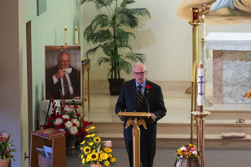 PMG PHOTO: CHRISTOPHER OERTELL - Forest Grove Mayor Peter Truax gives Tom Johnston's eulogy during a funeral service at the Visitation of the Blessed Virgin Mary Catholic Church in Verboort on Monday, Oct. 28.