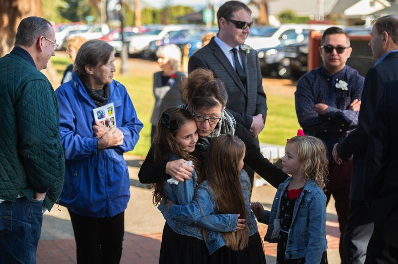 PMG PHOTO: CHRISTOPHER OERTELL - Raean Johnston speaks to family and friends before the funeral service for her husband, Tom Johnston, at the Visitation of the Blessed Virgin Mary Catholic Church in Verboort on Monday, Oct. 28.